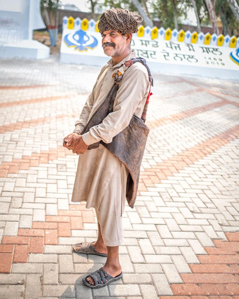 Mashak holding water bag. Photo by Amrinder Singh